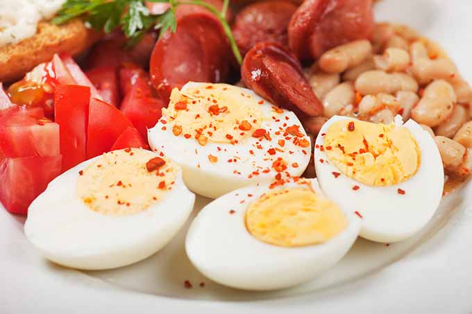 bigstock-Hard-boiled-chicken-eggs-with--47607313
