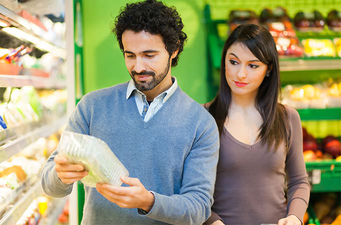 bigstock-Couple-shopping-in-a-supermark-87824297