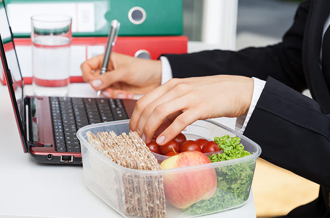 bigstock-Eating-And-Working-61679357