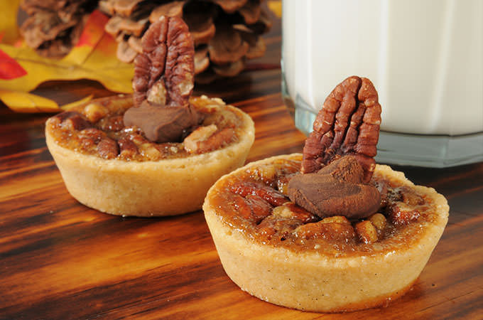 bigstock-Pecan-Tarts-With-A-Glass-Of-Mi-52712641