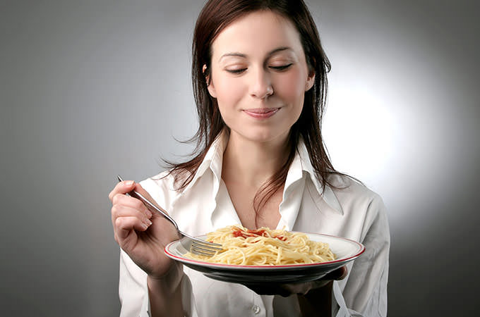 bigstock-a-young-woman-with-a-plate-of--12144779