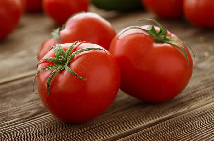 bigstock-Close-up-of-fresh-ripe-tomato-87474287