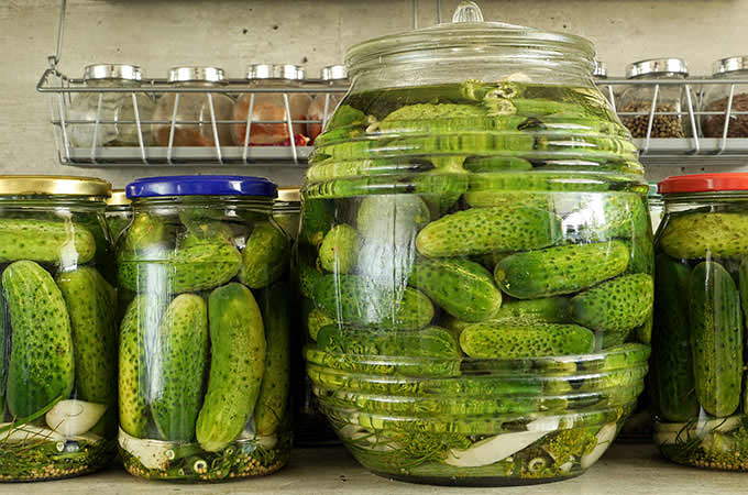 bigstock-Pickled-green-cucumbers-in-gla-49802981