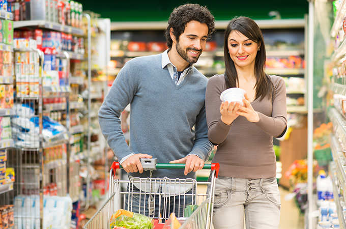 bigstock-Young-couple-shopping-in-a-sup-84668213