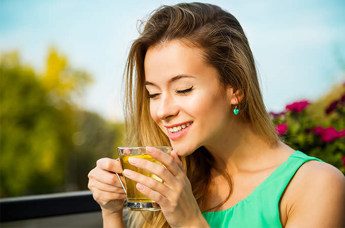bigstock-Happy-Woman-Drinking-Green-Tea-88819931(1)