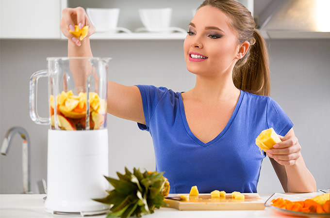bigstock-Juicing-woman-making-fruit-jui-81618824
