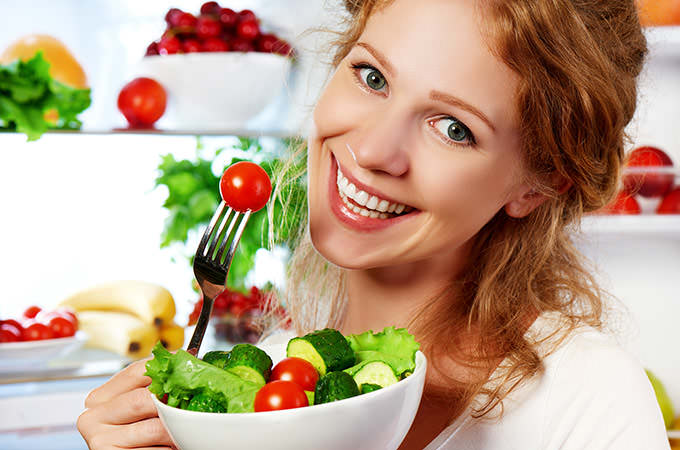 bigstock-Woman-Eats-Healthy-Food-Vegeta-94139600