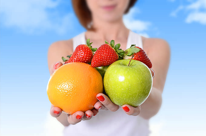 bigstock-Woman-Showing-Apple-Orange-Fr-86444738