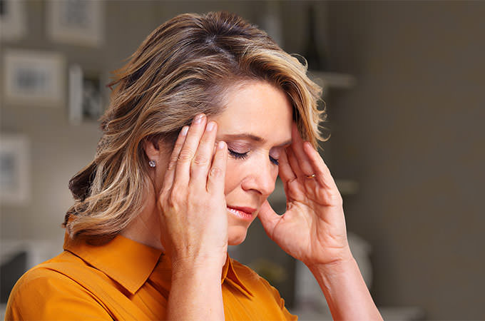 bigstock-Woman-having-headache-migraine-81248432