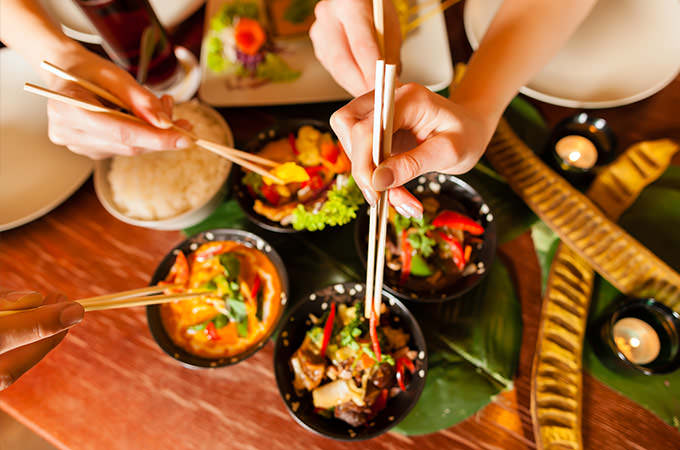 bigstock-Young-people-eating-in-a-Thai--34884905