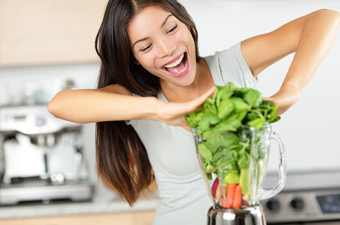 bigstock-Vegetable-smoothie-woman-makin-74368420