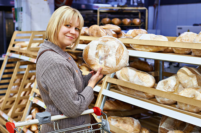 bigstock-Young-Woman-With-Bread-In-Supe-82606781