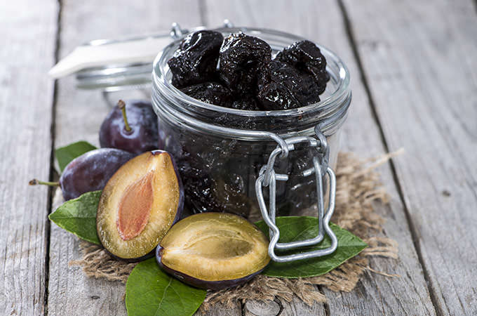 bigstock-Fresh-Dried-Plums-56087990