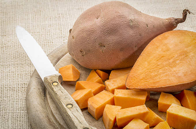 bigstock-sweet-potato-cut-and-diced-on--82374476