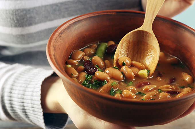 bigstock-Female-hands-with-beans-soup-i-86544527