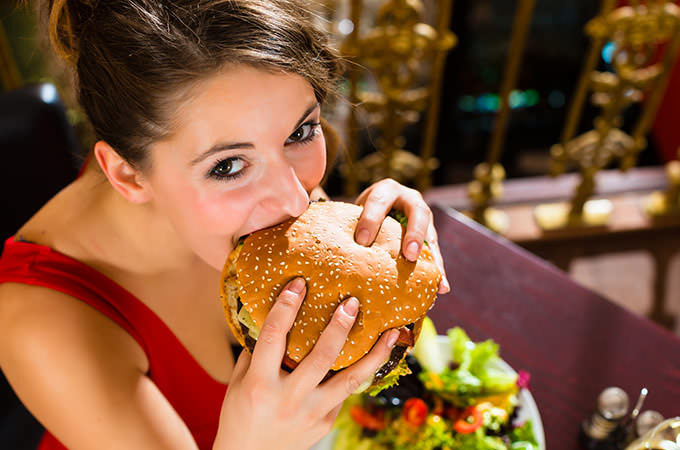 bigstock-Young-woman-in-a-fine-dining-r-41930269