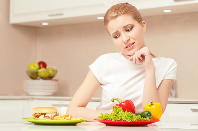 bigstock-Young-woman-choosing-lunch-88961201