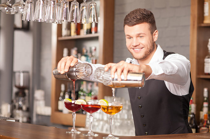 bigstock-attractive-young-barman-is-mak-103582034