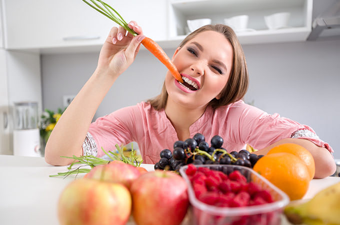 bigstock-funny-girl-biting-a-carrot-sh-77163977