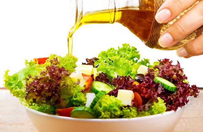 bigstock-Fresh-salad-with-olive-oil-iso-51537967_mini