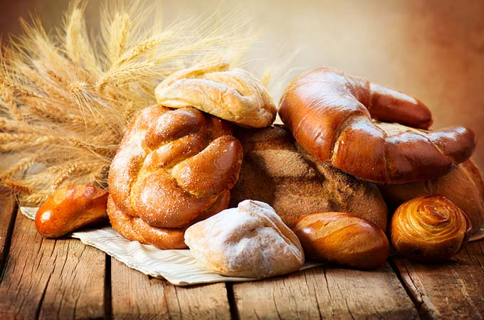 bigstock-Bakery-Bread-on-a-Wooden-Table-47966615