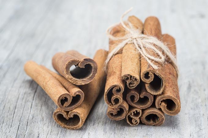 bigstock-Cinnamon-Sticks-On-A-Wooden-Ba-49719929_mini