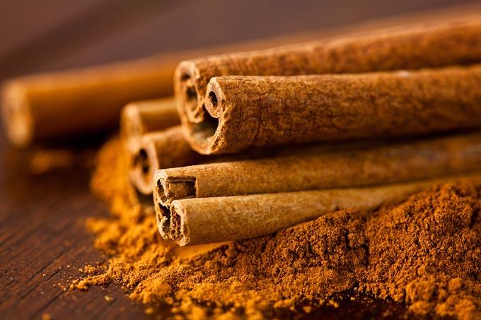 bigstock-Ground-cinnamon-and-cinnamon-s-18925820_mini