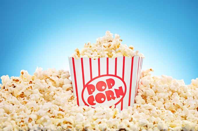 bigstock-Popcorn-in-classic-box-overflo-50177669