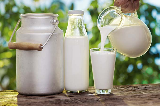 bigstock-Pouring-milk-in-the-glass-on-t-46131970