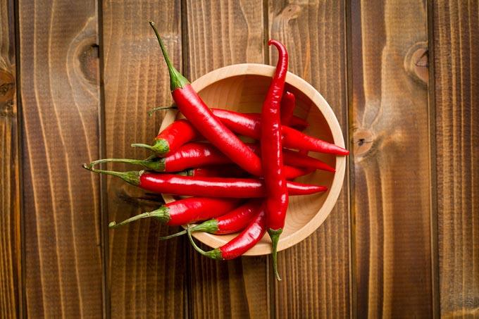 bigstock-top-view-of-chili-peppers-in-b-51670738_mini