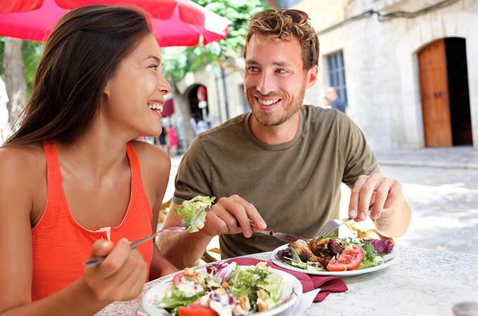 bigstock-Restaurant-tourists-couple-eat-82639652