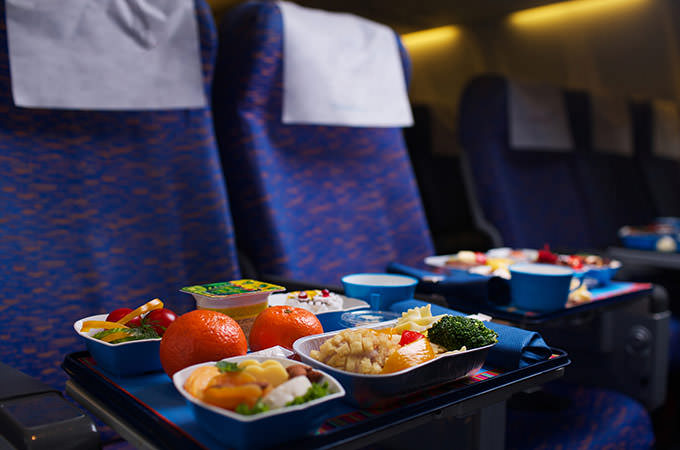 bigstock-Tray-of-food-on-the-plane-bus-34265474