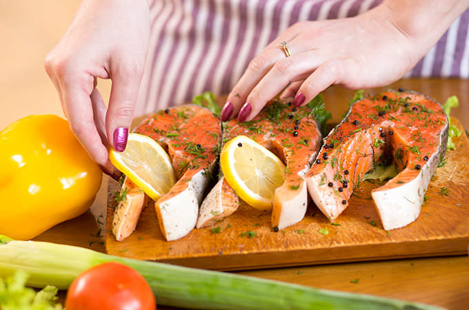 bigstock-Female-hands-close-up-cooking--90628352