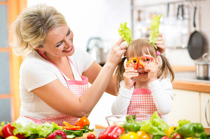 bigstock-Mother-And-Kid-Cooking-And-Hav-60604709