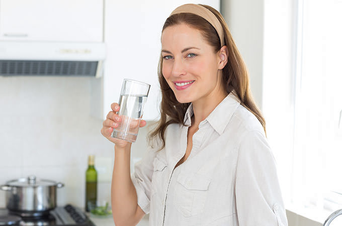 bigstock-Portrait-of-a-young-woman-drin-59027948