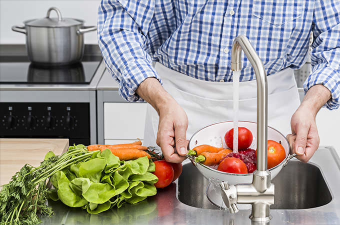 bigstock-Washing-Vegetables-In-Kitchen-88042019