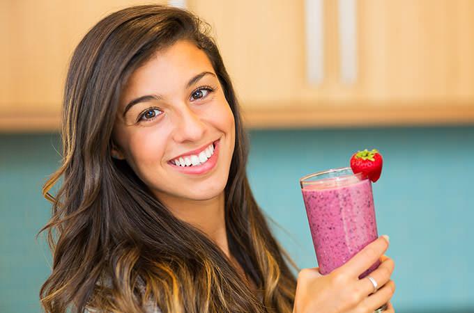 bigstock-Woman-Drinking-Fresh-Fruit-Smo-51850249
