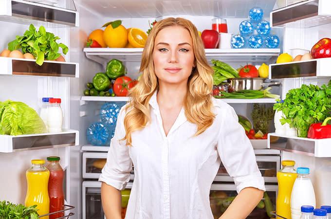bigstock-Woman-chosen-milk-in-opened-re