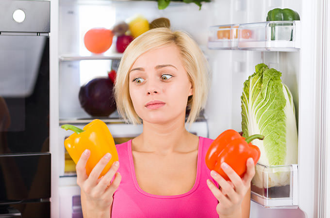 bigstock-girl-unhappy-look-red-pepper--65921974