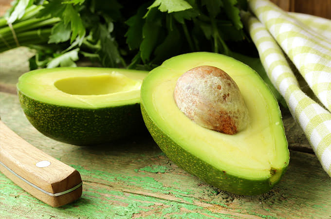 bigstock-ripe-avocado-cut-in-half-on-a--45744277