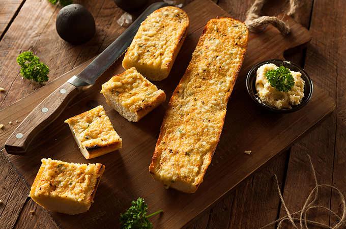 bigstock-Homemade-Cheesy-Garlic-Bread-91676162