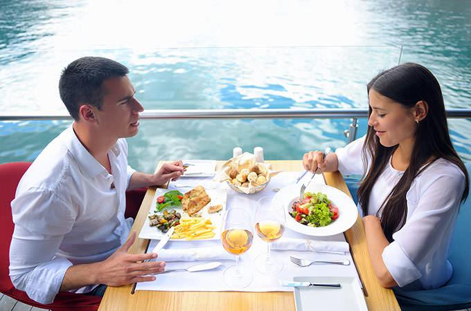 bigstock-happy-young-couple-having-lanc-63851692