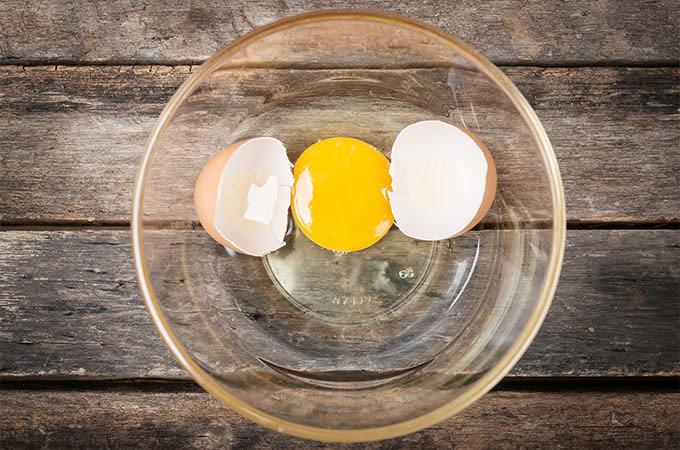 bigstock-Cracked-Chicken-Egg-With-Yolk--88454111