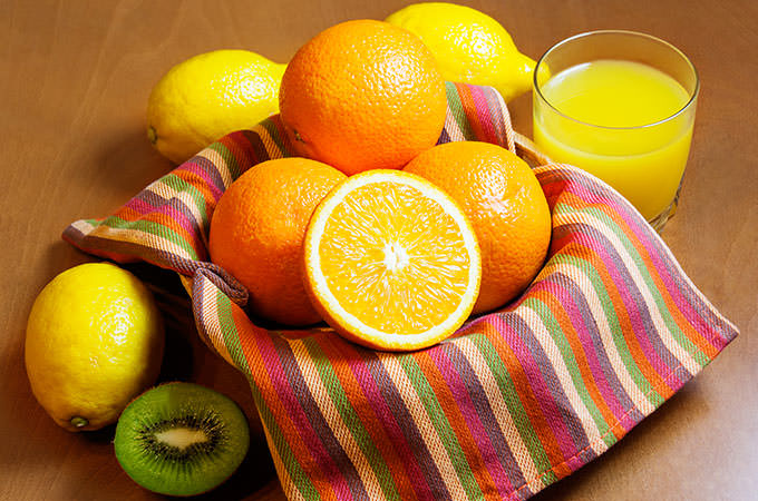bigstock-Oranges-Lemons-Kiwi-And-Gla-93947903