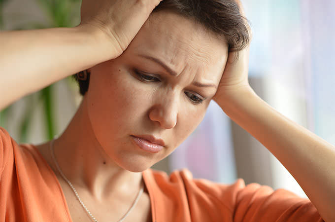 bigstock-Sick-woman-with-headach-92914118