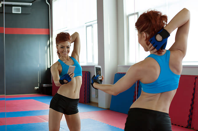 bigstock-Amusing-girl-photographing-her-70380016