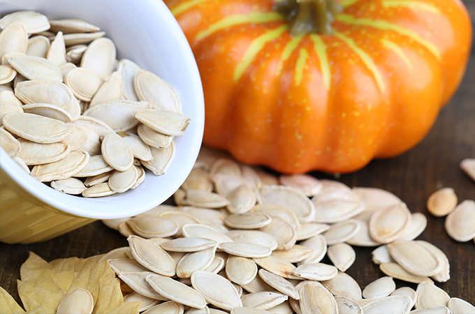 bigstock-Pumpkin-seeds-in-bowl-with-pum-56341094