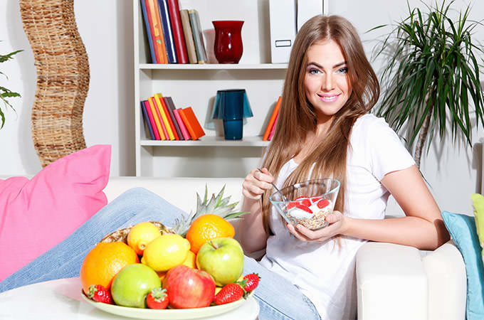 bigstock-Woman-Eating-Healthy-Breakfast-82006172