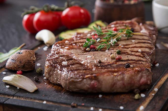bigstock-Beef-rump-steak-on-black-stone-87727904