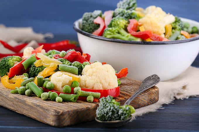 bigstock-Frozen-vegetables-on-cutting-b-82843199